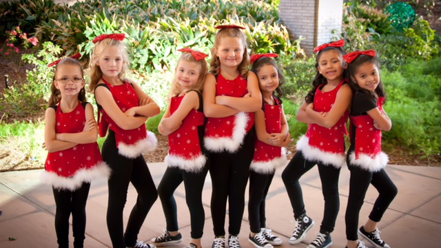 Kane Performance Team dancers pose for a shot before going on stage at the Festival of Lights, 2016